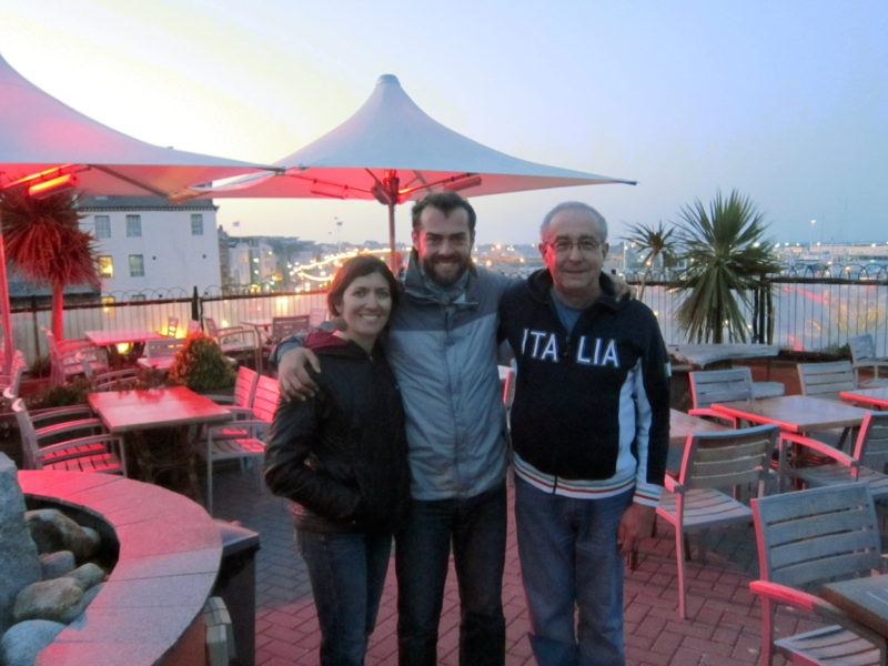 My wife Amy, me, and my father John (right) on a terrace overlooking St Peter Port.